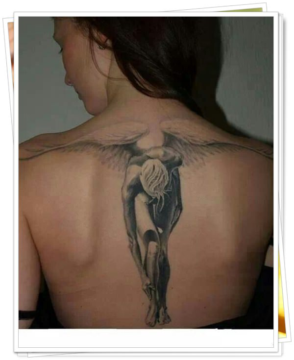 tattoo on womens back 2