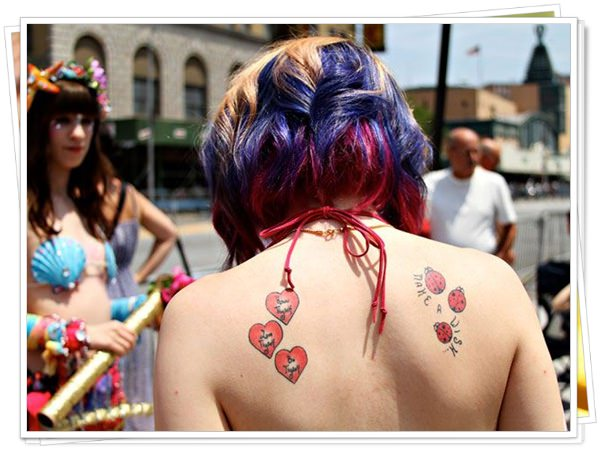 tattoo on womens back 57