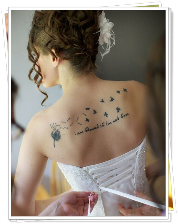 tattoo on womens back 8