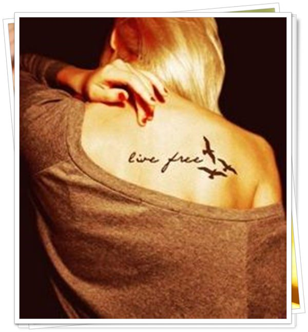 women's tattoos on the back 27