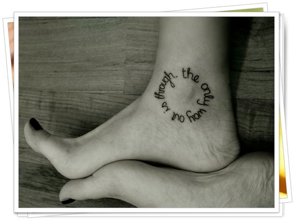 written ankle tattoo